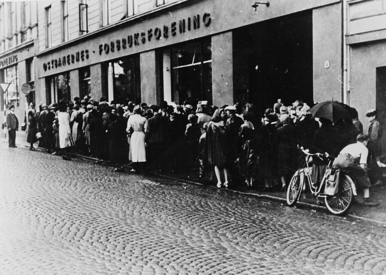 People waiting in line for food during WWII in Oslo, Norway.